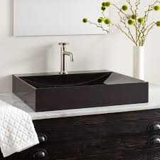rectangular black granite vessel sink with polished exterior