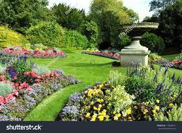 flowerbeds grass pathway ornamental vase formal stock photo