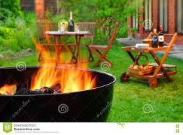 summer weekend bbq scene with grill on the backyard garden stock