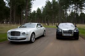 bentley vs chrysler logo bentley mulsanne v rolls ghost autocar