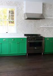 testing new kelly green paint colors for my kitchen cabinets