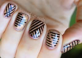 black striping tape nail design on glitter gel nails