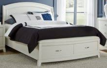 raised black wooden queen size bed frame with side storage drawers