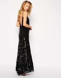 chrissy teigen models a black gown as she hits met gala with john
