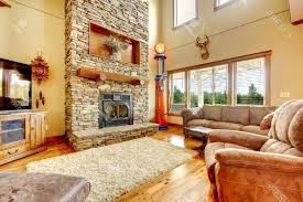 living room with fireplace and tv brown tile pattern area rugs