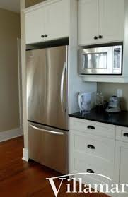 Microwave Kitchen Cabinets Microwave Shelf Dark Quartz With White Cabinets Stainless