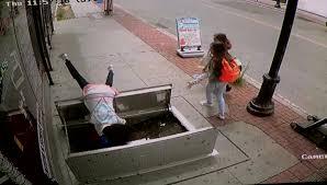 video woman falls down open sidewalk cellar door nbc4i com