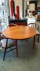 danish modern round teak dining table with 2 large drop in