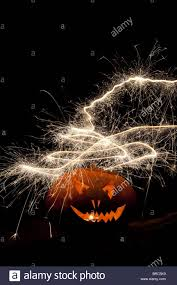 halloween pumpkin jack o lantern fire face and fireworks stock