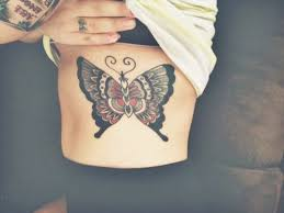 rib cage chest butterfly tattoos and piercings