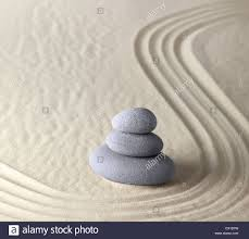 zen garden with rocks and sand stock photo royalty free image