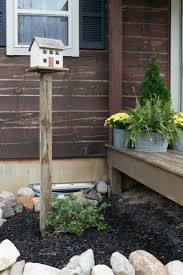 how to put a birdhouse post in the ground without post hole
