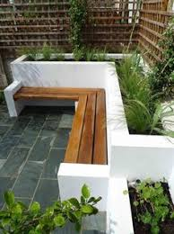 small courtyard designs patio contemporary with swan chairs decking hardscaping decking gardening exterior landscape