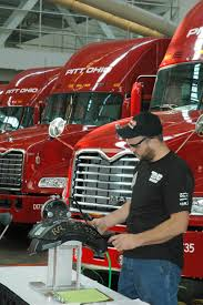 used mack trucks technicians test their skills on mack models at