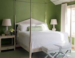 sage green wall paint colour combination with white bed for