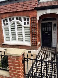 victorian garden walls front garden brick red wall metal gate rails planting balham