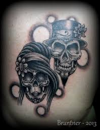 what are skull tattoos and what do they stand for bride and groom sugar skulls tattoo by brantnertattoo74 tattoos