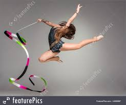 ribbon for hair that says gymnastics athletics teenager doing gymnastics dance with ribbon stock