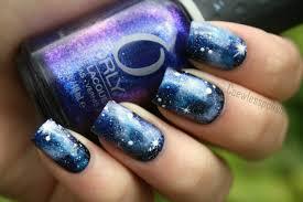 blue black and white galaxy nail art