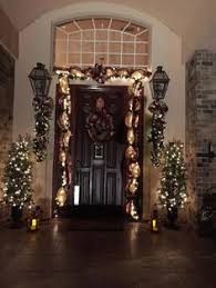 christmas swags for outdoor lights christmas decor love the monogram in the middle definitely