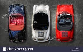 classic porsche black three classic porsche automobiles in black white red top down high