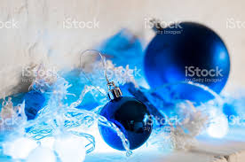 blue and silver ornaments on bright background stock