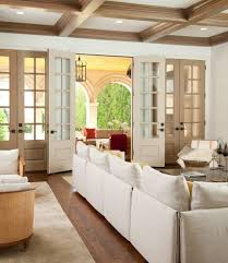 dark wood french doors family room mediterranean with light wood