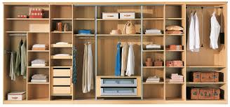 oversize wardrobe closet made of solid wood in light brown color