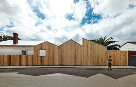 to shield an addition and new courtyard for a bungalow in greater architects
