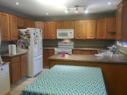 What Color To Paint Kitchen With Oak Cabinets by White And Blue Bathroom Has Subway Tiles In The Bathtub Nook