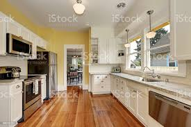 yellow kitchen walls white cabinets kitchen interior with white cabinets yellow walls and wood floor stock photo image now