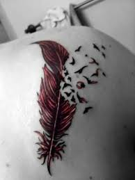 upper side back feather bird tattoo design made by colorful ink