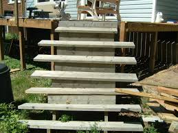 installing new deck stairs thumb and hammer