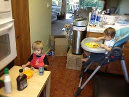 feeding kids at dining room table over carpet san diego moms blog