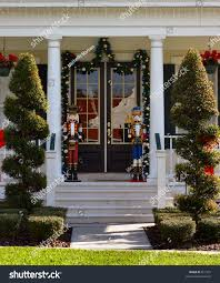 toy soldier christmas decoration on front stock photo 811557 toy soldier christmas decoration on front porch with topiearies