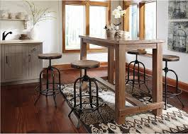 rustic style 5 piece pub set wood and cast iron stools with a