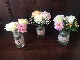 wedding flowers jam jars trio of jam jars weddimg flower centerpieces wedding gallery