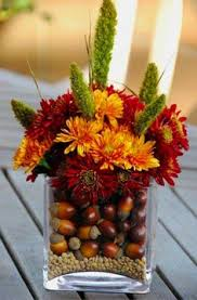 Fall Floral Decorations - pumpkins hanging from twigs fall centerpiece thanksgiving table