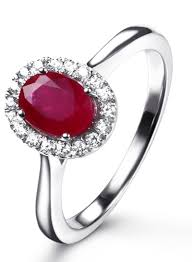 classic 1 carat ruby and diamond halo engagement ring in white