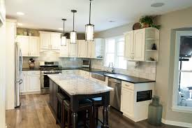 adding an island to an existing kitchen painting existing cabinets and adding an island made a dramatic