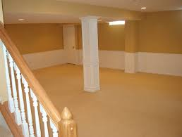 small and low ceiling basement design after remodel with white and