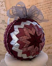 victorian folded fabric christmas ornament in mauve and silver