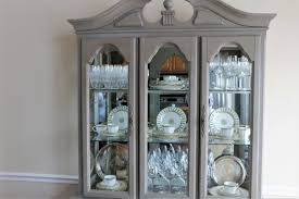 how to arrange dishes in china cabinet curating your china cabinet magnolia stripes