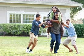 Backyard Football Free Family Playing Football In Backyard Stock Photo Dissolve