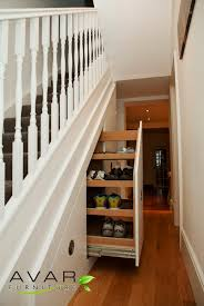 regal custom carpenter made shoes racks storage under stairs with