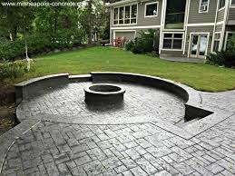 stamped concrete patio with raised firepit www minneapolis
