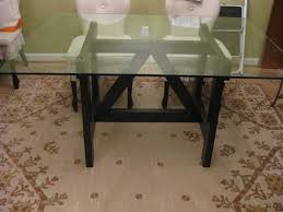 glass top dining table with natural wood base for clean color and