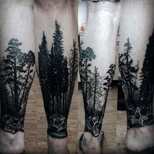 skull with trees forest tattoos for on lower leg