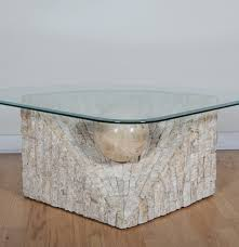 modern glass top and tessellated stone table ebth