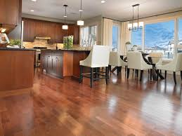 wooden laminate flooring in modern living room with open kitchen
